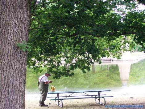 man tying a fishing lure onto his line