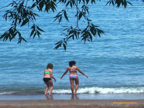 two friends watch waves