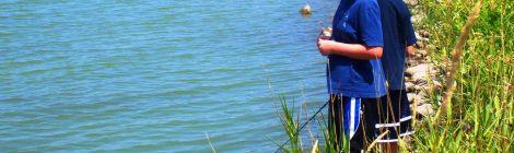 boys fishing at lake