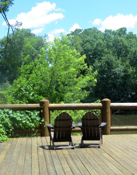 log fence and deck chairs