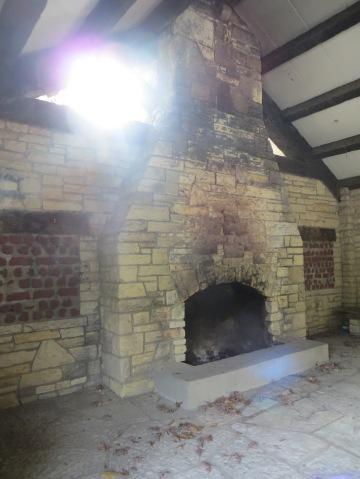 stone and log shelter