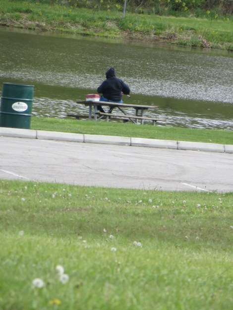 fisherman on a bench